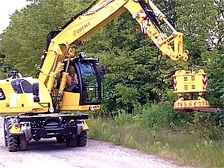 MHM hydraulic scrap magnet at track dismantling with a road rail excavator